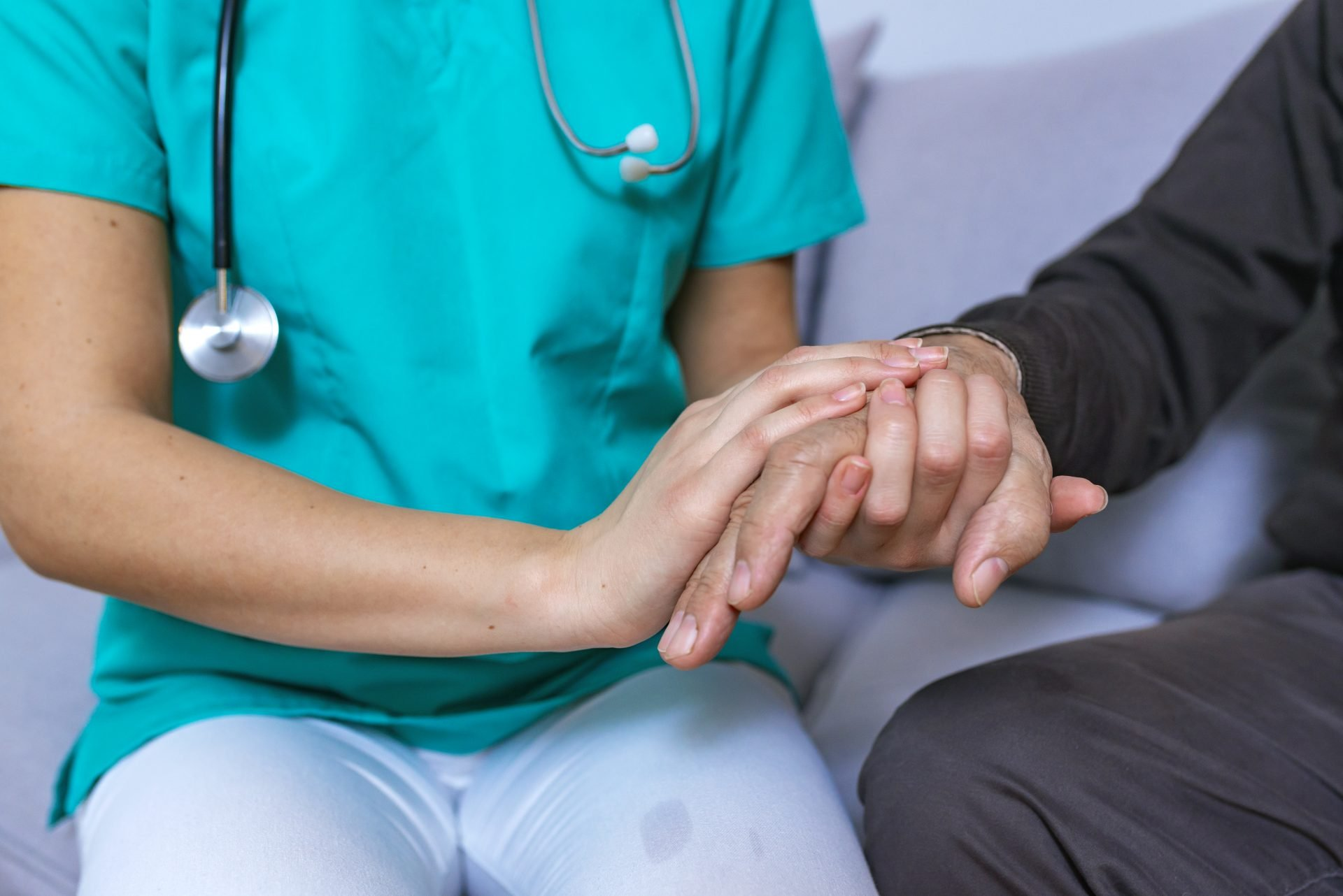 Medical Employee Caring for Patient