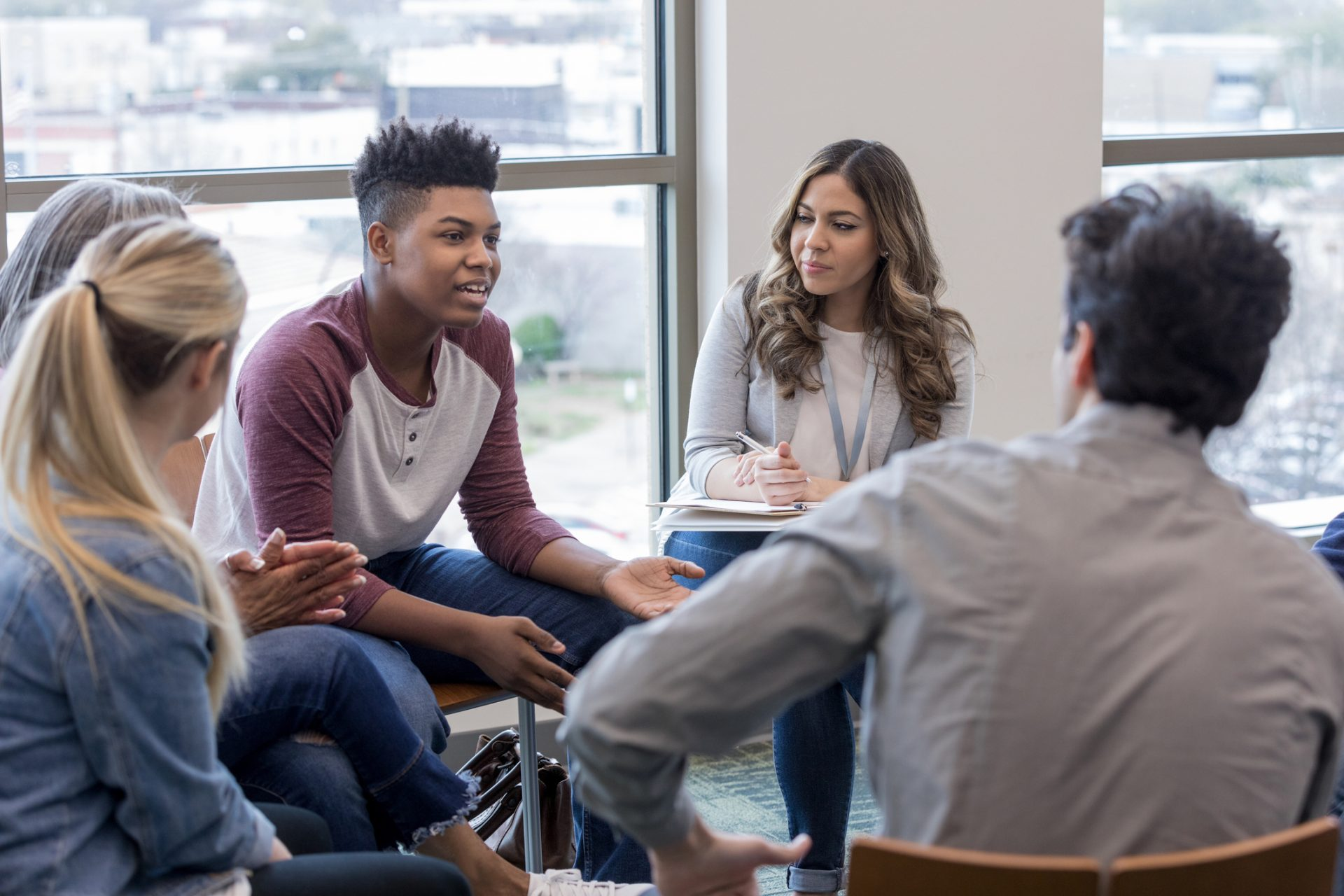 young man talking in group circle