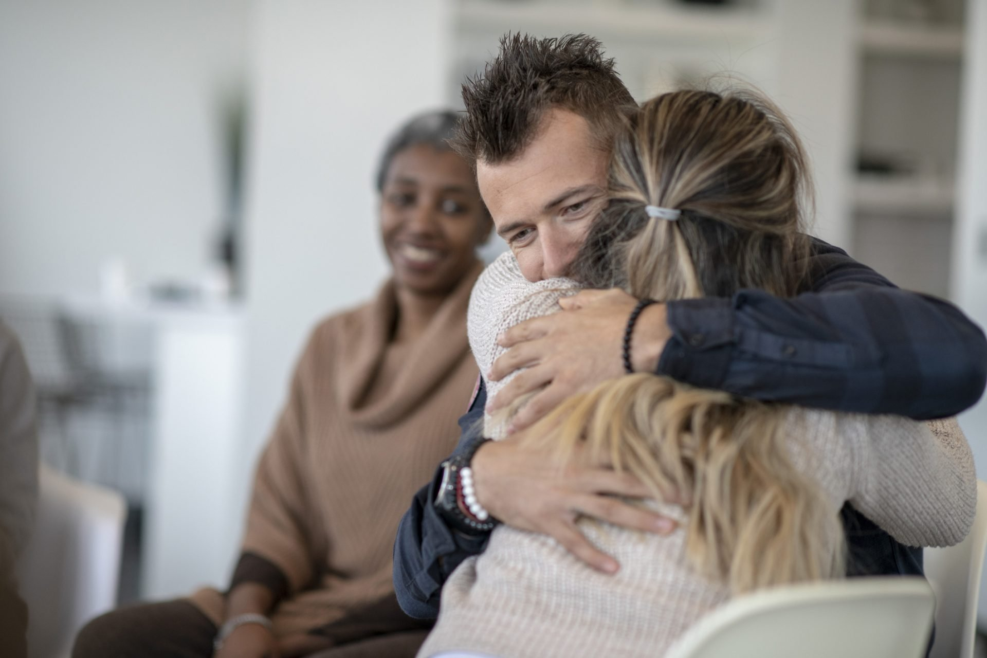 Man Hugging Woman in Therapy