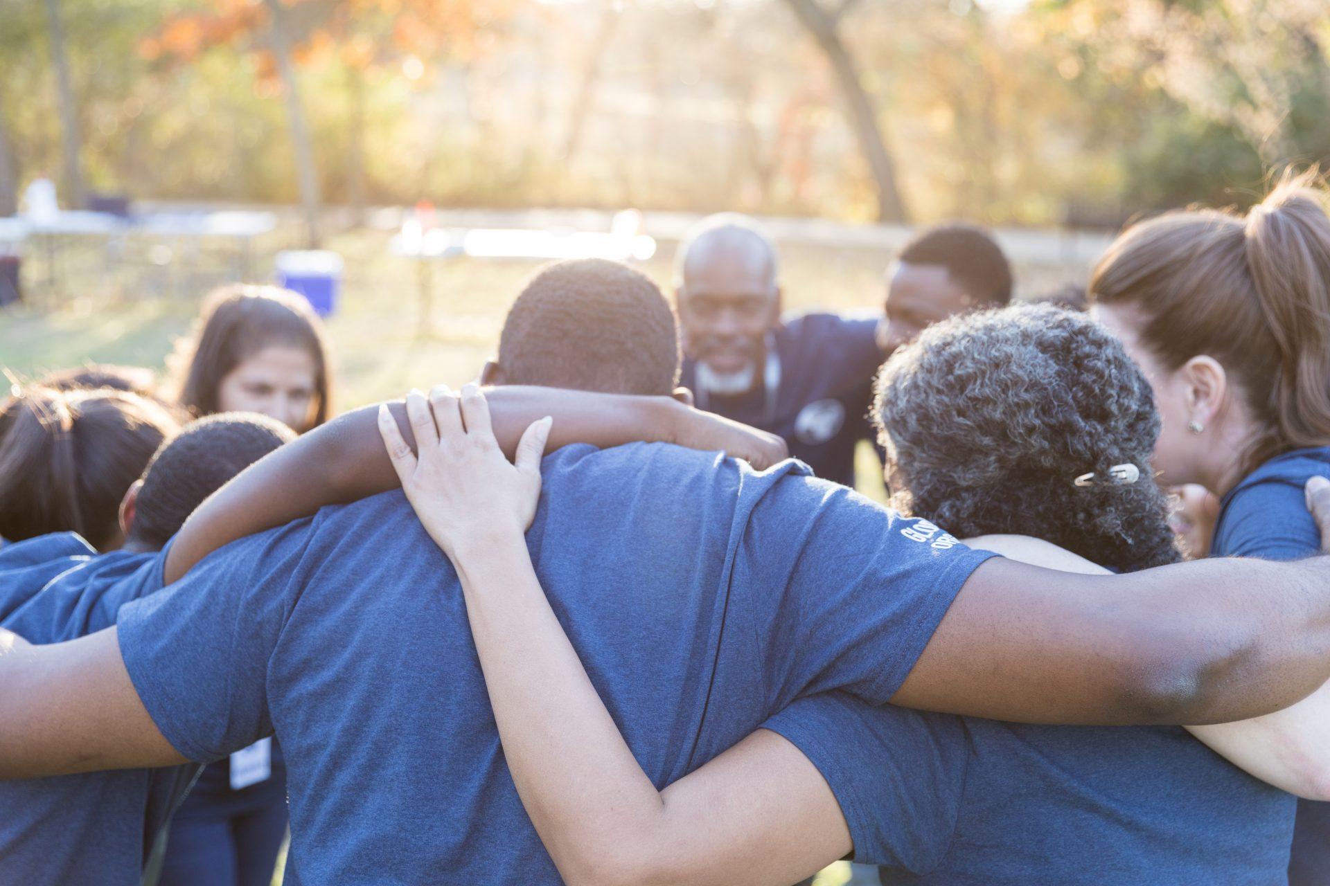 Group huddle between volunteers