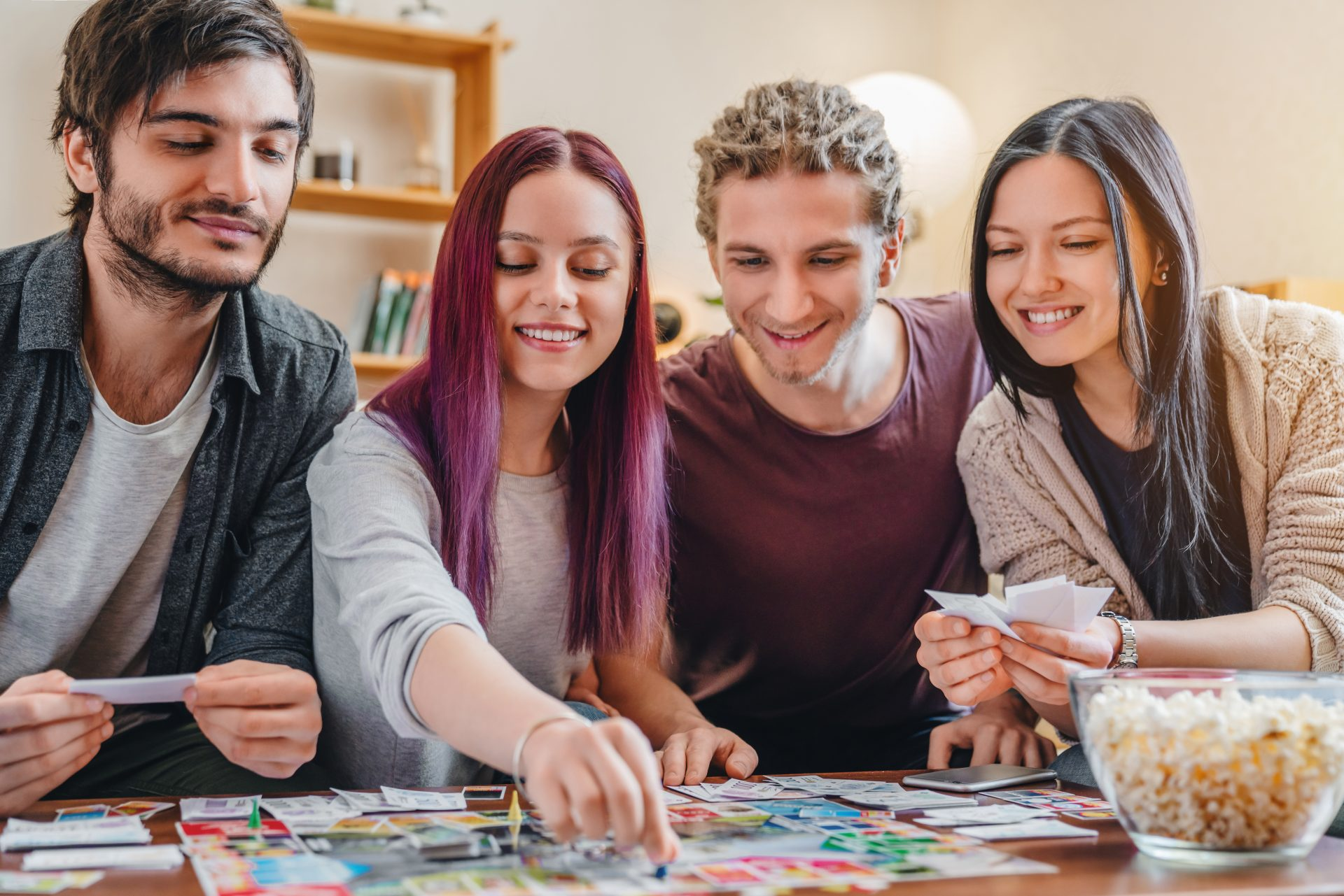 Group of friends gathering around board game